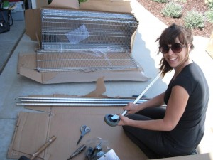 Lisa putting together a Stainless Steel Shelving Unit from Home Depot. We always add the optional industrial casters.