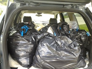 A dozen bags of shoes and clothes on its way to assist others in San Diego after the fires.
