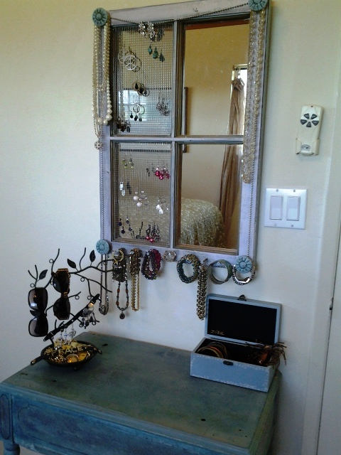 By keeping the mirror behind the frame I get a jewelry organizer and a mirror all in one.